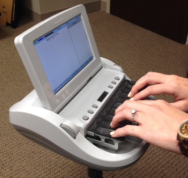 Court reporting stenography machine similar to machines used by court reporters at Urlaub Bowen & Associates in Chicago, IL.
